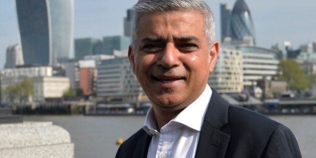 Britain's newly elected mayor Sadiq Khan speaks to supporters as he arrives for his first day at work...