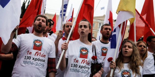 A member of the communist-affiliated PAME shout slogans during a rally commemorating May Day, which was...