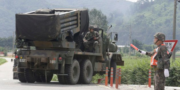 South Korean army's armored vehicle moves in Yeoncheon, south of the demilitarized zone that divides...