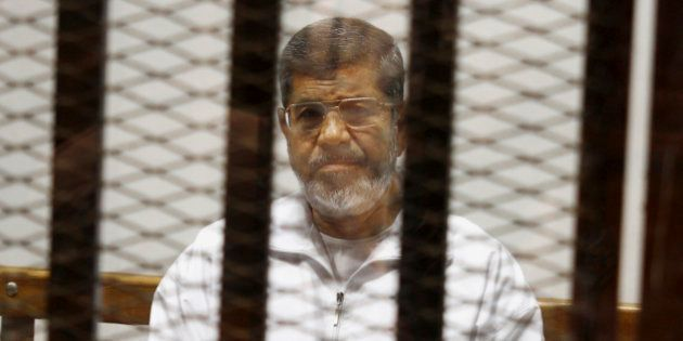 FILE - In this May 8, 2014 file photo, Egypt's ousted Islamist President Mohammed Morsi sits in a defendant...
