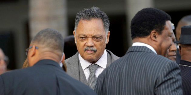 The Rev. Jesse Jackson leaves funeral services for singer Natalie Cole at West Angeles Church of God...