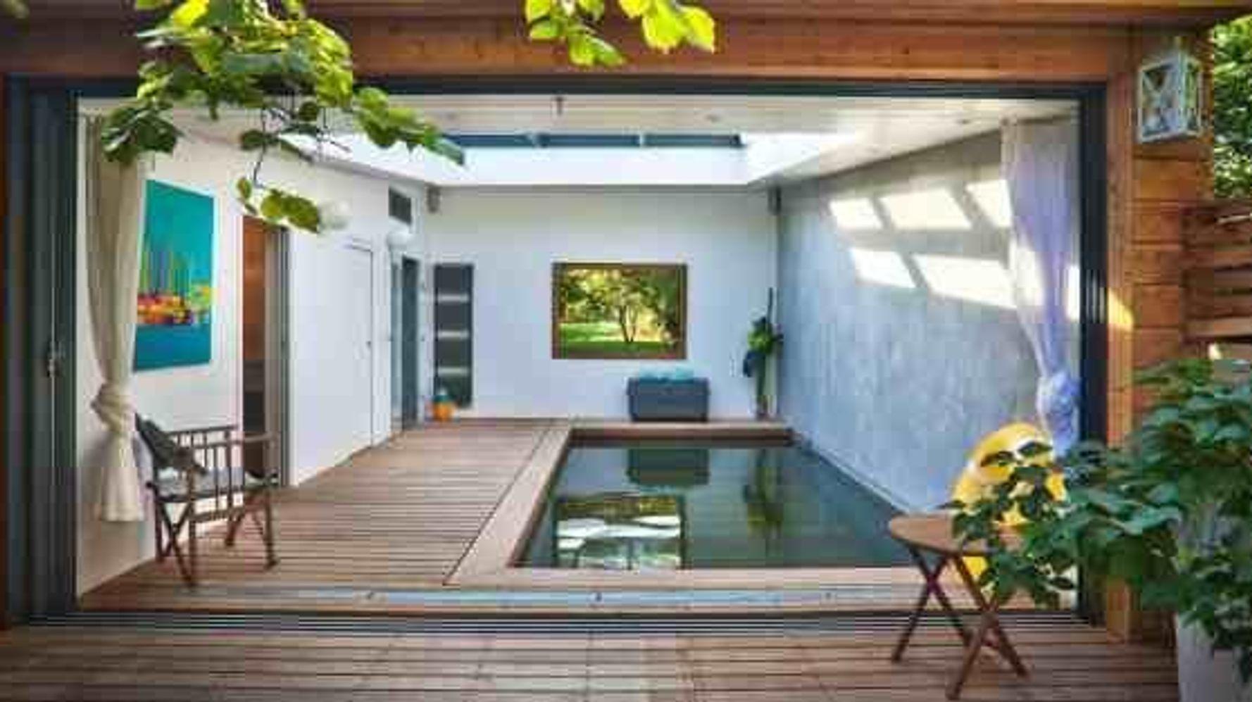 Extension Maison Piscine Couverte photos. cette piscine couverte donne envie de s'installer en