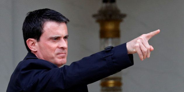 French Prime Minister manuel Valls gestures as he leaves the weekly cabinet meeting at the Elysee Palace...