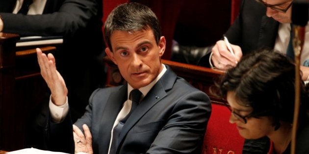 French Prime Minister Manuel Valls reacts before a no-confidence vote against French government at the...
