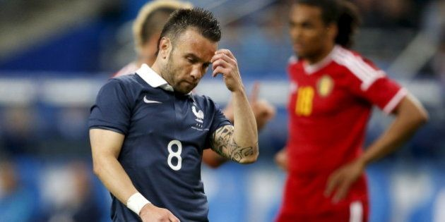 France's Mathieu Valbuena (L) reacts during an international friendly soccer match against Belgium at...