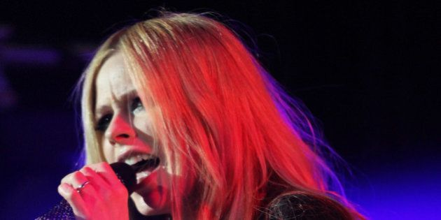 Avril Lavigne performing as part of the Star 94 Jingle Jam 2013 at The Arena at Gwinnett Center on Monday,...