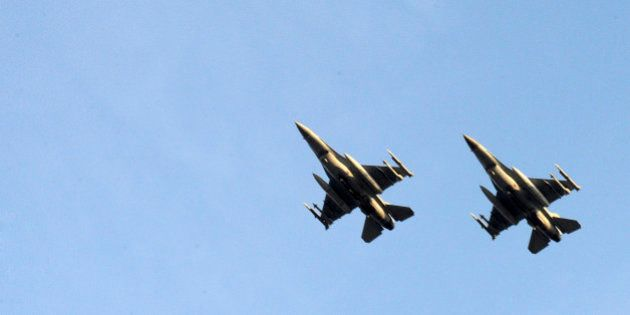 Two Belgian F-16 fighter jets fly over Araxos airport in Kato Ahaia, Greece on Monday, March 28, 2011....