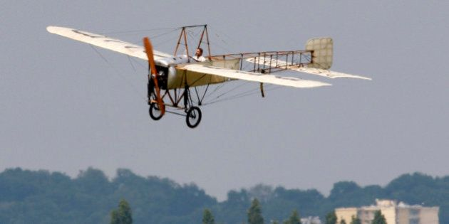 A Bleriot 11/2 monoplane takes part during a flying display at the Le Bourget airport near Paris, June...
