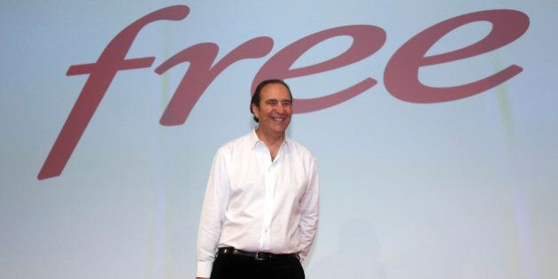 French provider of phone, Internet and TV services group Iliad SA's chairman Xavier Niel smiles during...