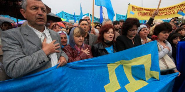 Crimean Tatars gather to commemorate the mass deportations from the region in 1944 during a rally in...