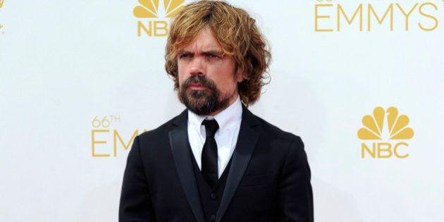 Peter Dinklage arrives at the 66th Primetime Emmy Awards at the Nokia Theatre L.A. Live on Monday, Aug....