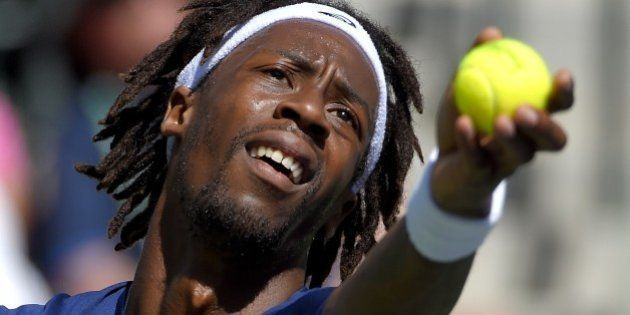 Gael Monfils, of France, serves to Pablo Carreno Busta, during their match at the BNP Paribas Open tennis...