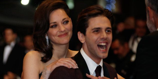 Director Xavier Dolan and cast member Marion Cotillard pose on the red carpet as they arrive for the...