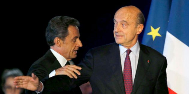 Former French President Nicolas Sarkozy (L) attends a political rally with Bordeaux's mayor Alain Juppe...