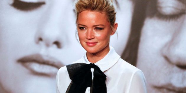 Actress Virginie Efira poses during a photocall as she attends the 2014 Lumiere Film Festival in Lyon,...