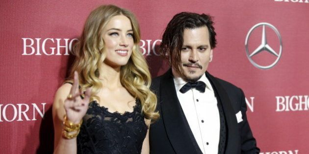 Desert Palm Achievement Award recipient actor Johnny Depp and wife actress Amber Heard pose at the 27th...