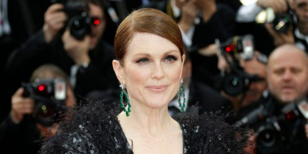 Julianne Moore arrives for the opening ceremony and the screening of the film La Tete en Haut (Standing...