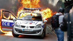 Voiture de police brûlée: un Américain de 27 ans mis en examen et