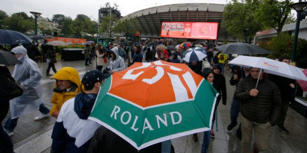 Tennis - French Open - Roland Garros - France - Paris, France - 30/05/16 - Spectators leave after matches...