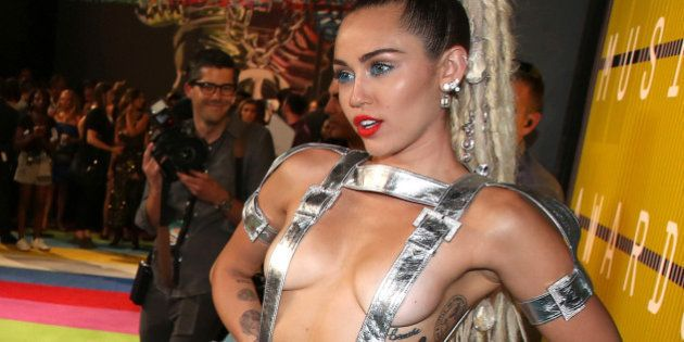 Miley Cyrus arrives at the MTV Video Music Awards at the Microsoft Theater on Sunday, Aug. 30, 2015,...