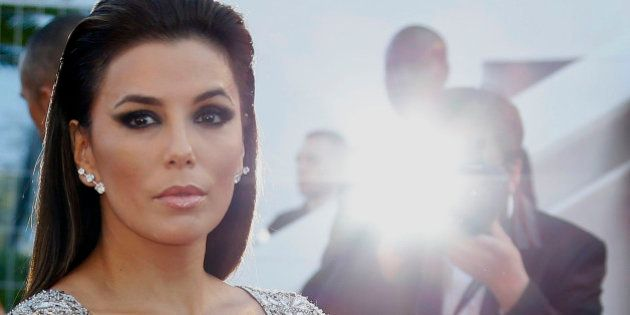 Actress Eva Longoria poses on the red carpet as she arrives for the screening of the animated