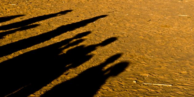 Djabal refugees camp - shadows of some sudanese people gathered in the
