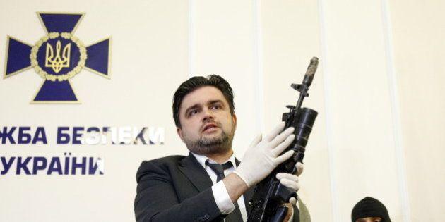 Markian Lubkivskyi, advisor of the Ukraine's Security Service (SBU) head, demonstrates Kalashnikov automatic...
