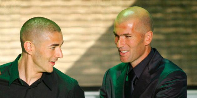 Lyon's Karim Benzema, left, reacts after he was voted 'best soccer player' of France's League One as...
