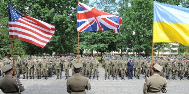 Polish Army soldiers hold flags of some of the countries participating in the Anaconda-16 military exercise,...