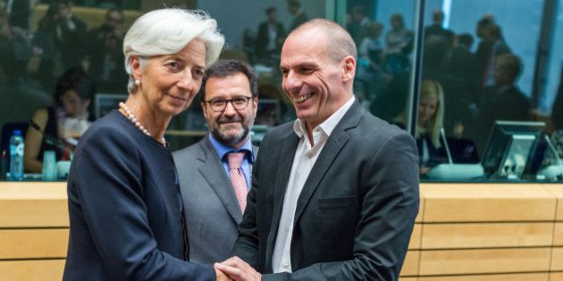 Managing Director of the International Monetary Fund Christine Lagarde, left, greets Greek Finance Minister...