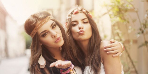 Beautiful boho girl blowing a kisses