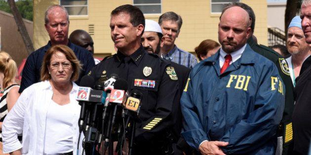 Orange County Mayor Teresa Jacobs, Orlando police chief John Mina and FBI agent Ron Hopper speak at a...