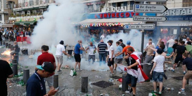 French police use tear gas against England supporters in downtown Marseille, France, Friday, June 10,...