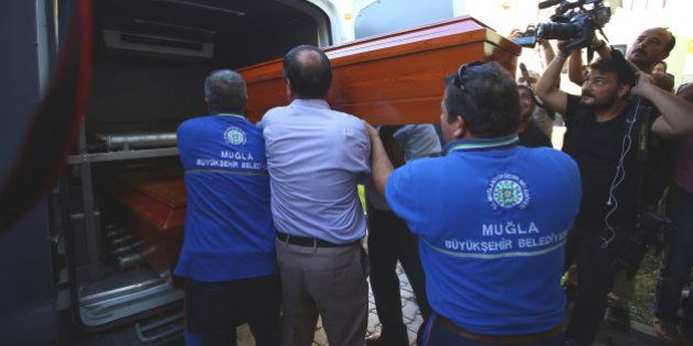 Officials carry the coffin of Rehan Kurdi, the mother of Syrian boys Aylan, 3, and Galip, 5, who were...
