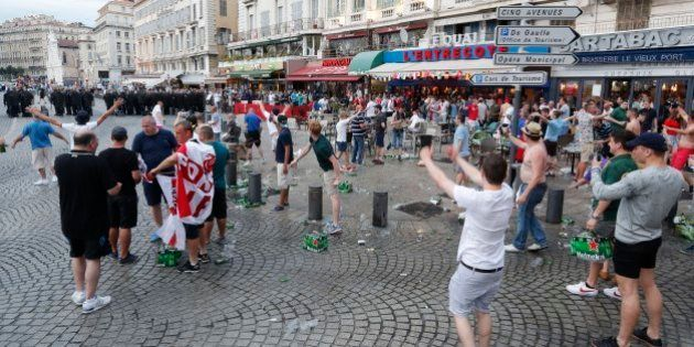 England supporters taunt a line of French riot police officers in downtown Marseille, France, Friday,...