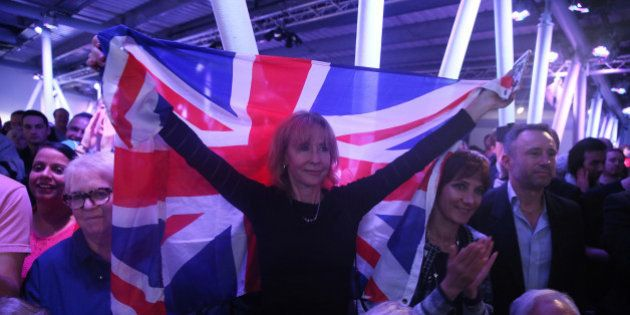 A Brexit supporter holds a Union Flag at a Vote Leave rally in London, Britain June 4, 2016. REUTERS/Neil