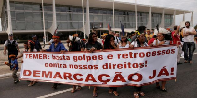 Indigenous people of the Guarani-Kaiowa tribe take part in a protest asking for the demarcation of their...