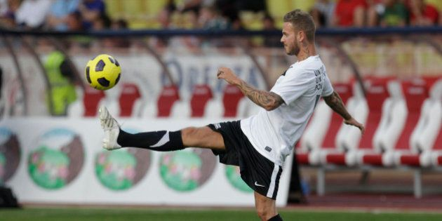 French artist Matt Pokora warms up before a charity match between Olympique Marseille soccer team and...
