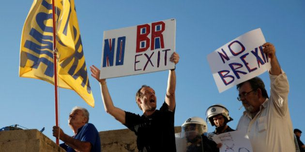 Anti-government demonstrators hold placards
