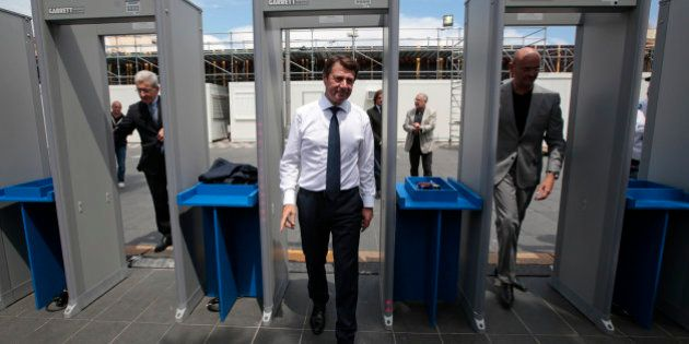 President of the Provence Alpes Cote d'Azur (PACA) region Christian Estrosi (C) arrives at a security...