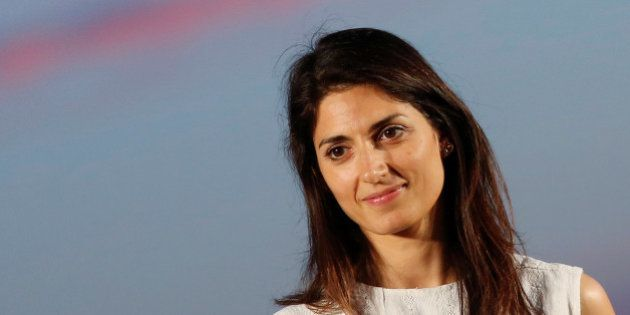 Virginia Raggi, 5-Star Movement candidate for Rome's mayor, stands on stage during a rally in Ostia,...