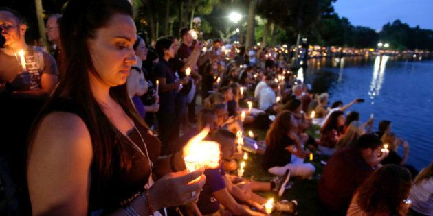 Supporters of the victims of the recent mass shooting at the Pulse nightclub attend a vigil at Lake Eola...
