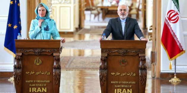 Iranian Foreign Minister Mohammad Javad Zarif, right, speaks during a press conference with European...