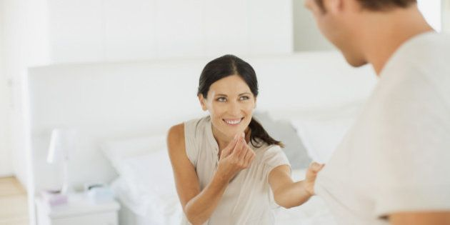 Couple playing together in bedroom