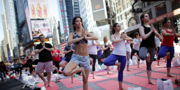 NEW YORK - JUNE 21: Over 8,000 people practice yoga as a salute to the sun at the 12th Annual Solstice...