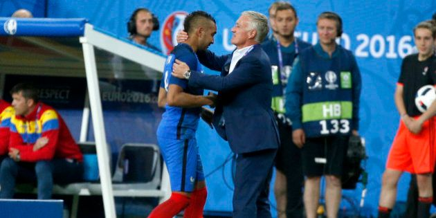 France coach Didier Deschamps hugs France's Dimitri Payet, left, as he leaves the pitch after being substituted...