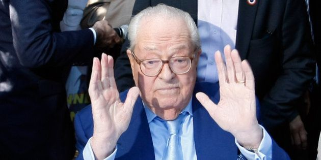 Jean-Marie le Pen, former head of the far-right party National Front, gestures after a press conference...