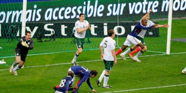 Ireland's goalkeeper Shay Given (L) reacts after controversial goal by France's William Gallas (2nd R)...
