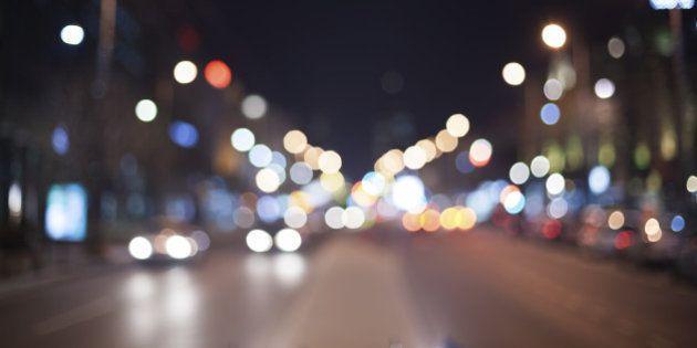 Blured night lights in traffic. Grain
