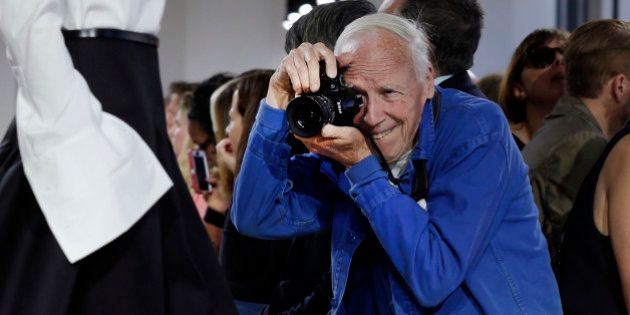New York Times photographer Bill Cunningham shoots the Michael Kors Spring 2015 collection, during Fashion...